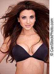 Busty woman modeling a bikini - Upper body portrait of a...