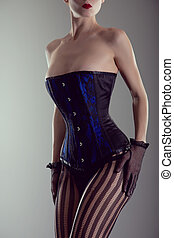 Busty woman wearing black and blue corset - Busty woman...