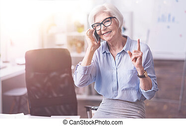 Busy ambitious businesswoman asking to hold on