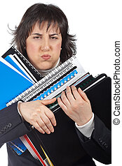 Busy business woman carrying stacked files
