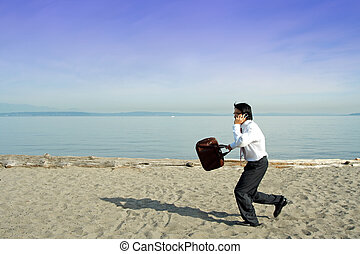 Busy businessman - A businessman running and talking on the...