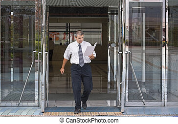 Busy businessman - Businessman getting out of a corporate...