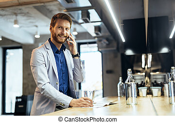 Busy businessman talking on phone