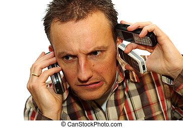 Busy businessman with 3 cell phones getting answers
