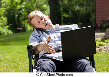 Busy businessman working in the garden