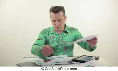 Busy businessman working with table