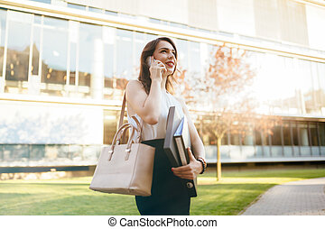 Busy businesswoman talking on phone