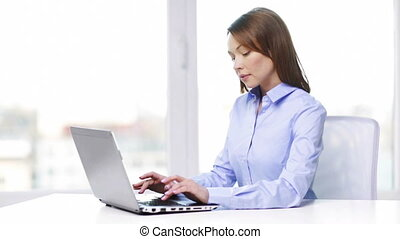 busy businesswoman with laptop in office
