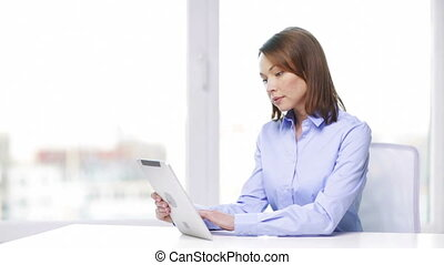 busy businesswoman with tablet pc in office