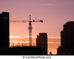 Busy City Construction Site at Sunset