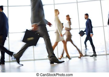 Busy come busy go - White collar workers going down office...