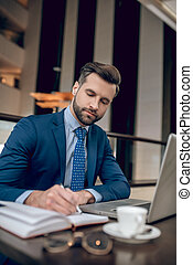 Elegant businessman working in the office and looking involved