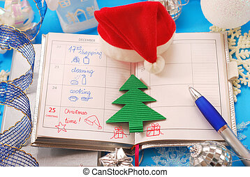 busy days before christmas - notebbook with written schedule...