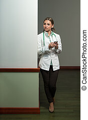 Busy Doctor Woman Texting On Her Cell Phone