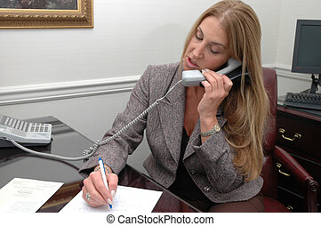 busy executive - busy business executive on the phone