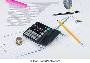 Busy financial desktop with calculator, money and charts