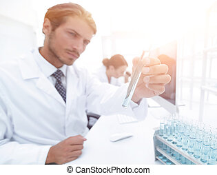 Busy group of researchers carrying out experiments