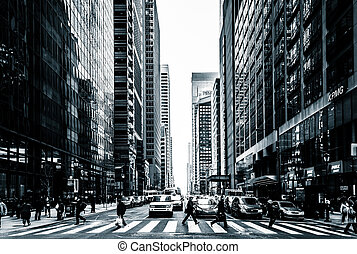 Busy intersection and skyscrapers in Center City, ...