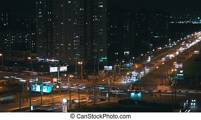 Busy intersection in the night city - Timalapse of busy...