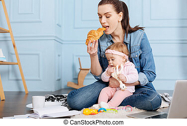 Busy inventive mom eating brunch with her daughter