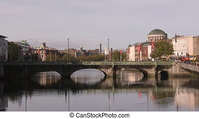 Busy Ireland bridge - A steady shot of a bridge where people...