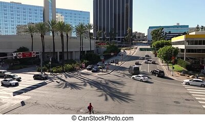 Busy Los Angeles intersection at Figueroa and 3d street. City center transportation System.