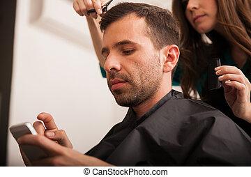 Busy man in a hair salon