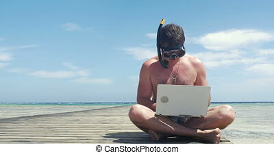 Busy Man in Snorkel and Mask with Laptop - Man in snorkel...