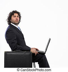 Busy man with briefcase and laptop isolated on white...