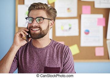 Busy man talks on the phone
