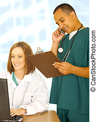 Busy Medical Staff Doing Various Things - two medical staff...