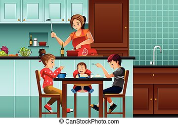 Busy mother in the kitchen with her kids