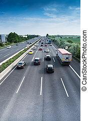 busy motorway - cars and lorries on highway