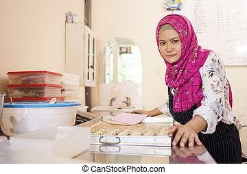 muslim female baker at her workshop
