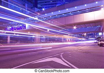 Busy night traffic in business district of modern city