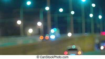 Busy overpass defocused night traffic and line of street...