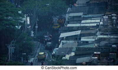 Busy Road In East Asian City In Rain Shower - Busy road with...