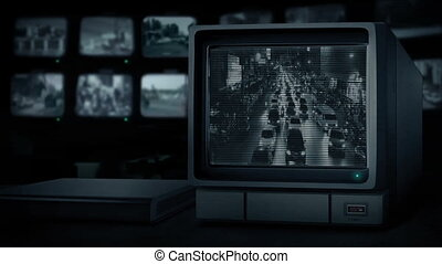 Busy Road Through City On CCTV Monitor - CCTV view of main...
