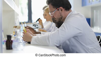 Busy Scientific Team Of Researchers In Laboratory Scientists...