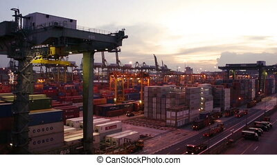 Busy Seaport - A massive Cranes moving in a harbor with a...