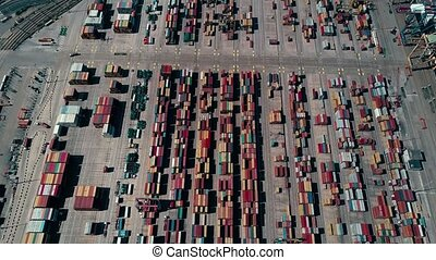 Busy seaport container terminal traffic, aerial view -...