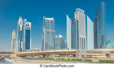 Busy Sheikh Zayed Road timelapse, metro railway and modern...