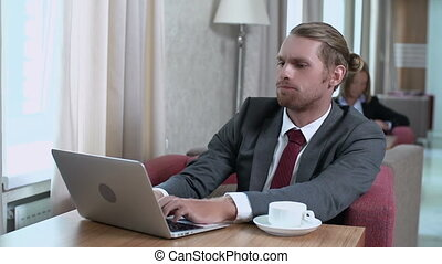 Busy Stranger - Man activating laptop and getting straight...