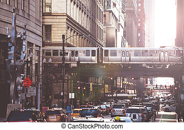 Busy street in Chicago downtown cars and metro