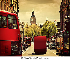 Busy street of London, England, the UK. Red buses, Big Ben ...