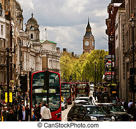 Busy street of London, England, the UK. Red buses, Big Ben...