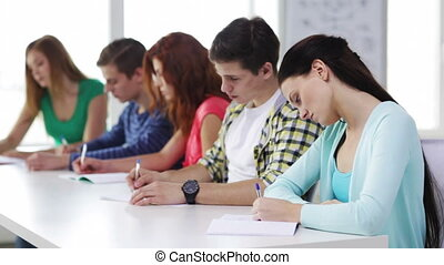 busy students with textbooks at school