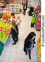 Busy Supermarket - High angle view of people buying in...