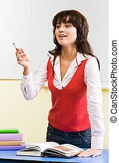 Busy teacher - Portrait of confident teacher standing at her...