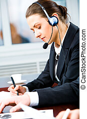 Busy telephone operator - Portrait of telephone operator ...